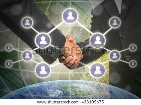 Business handshake with Social media symbol over the building and world map background, Elements of this image furnished by NASA, Business social network concept