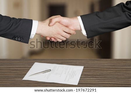 business handshaking in office - stock photo