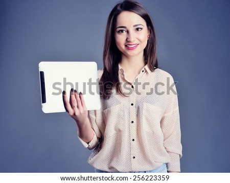 business happy woman with the tablet