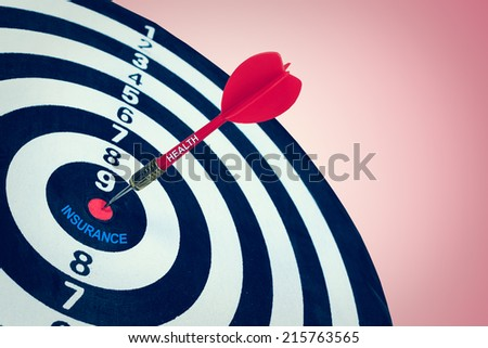 Business health insurance concept and darts board - stock photo