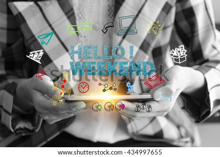 business holding a smart phone with HELLO WEEKEND text on black and white background ,business analysis and strategy as concept