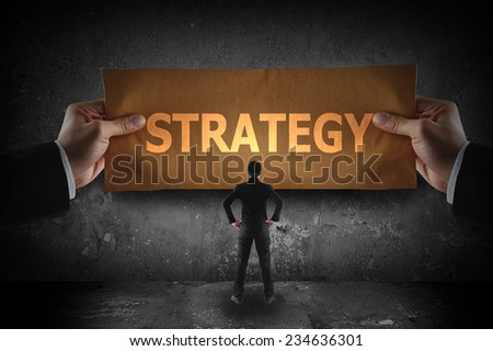 Business holding sign strategy on paper - stock photo