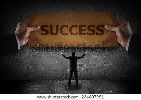 Business holding sign success on paper - stock photo