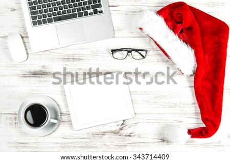 Business Holidays Concept. Office Workplace with Cup of Coffee and Christmas Decoration - stock photo