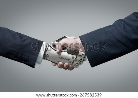 Business Human and Robot hands in handshake. Artificial intelligence technology Design Concept - stock photo