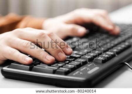 Business human hand working pc computer keyboard - stock photo
