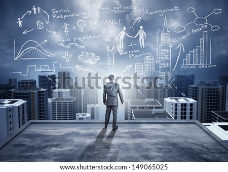 Business Ideas - conceptual. A businessman watching the city with big ideas. - stock photo