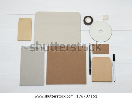 Business Identity Mockup Item Set On White Wooden Desk