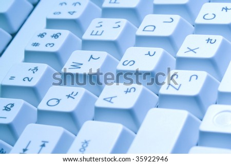 BUSINESS IMAGE-close-up shot of the white keyboard with blue light