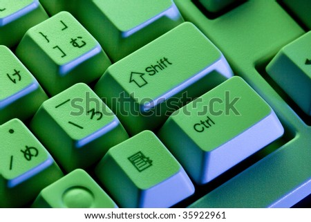 BUSINESS IMAGE-close-up shot of the white keyboard with green light