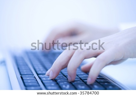 BUSINESS IMAGE- woman's hands typing the black keyboard