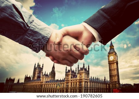 Business in London. Handshake on Big Ben, Westminster background. Deal, success, contract, cooperation concepts  - stock photo