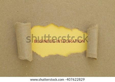Business Integration Word written under torn paper. - stock photo