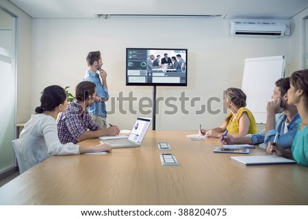 Business interface against attentive business team following a presentation