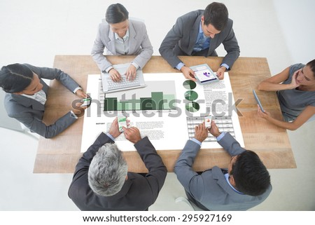 Business interface against business people in meeting with new technologies - stock photo