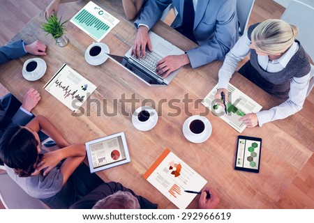Business interface against business team discussing the graphs - stock photo