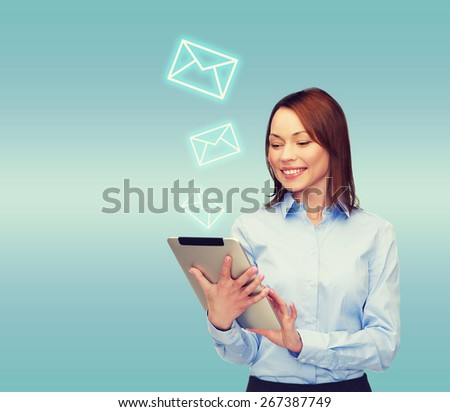business, internet and technology concept - smiling woman looking at tablet pc computer - stock photo
