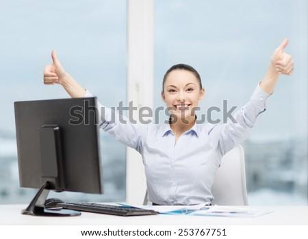 business, internet, office and technology concept - smiling businesswoman with computer and paper showing thumbs up - stock photo