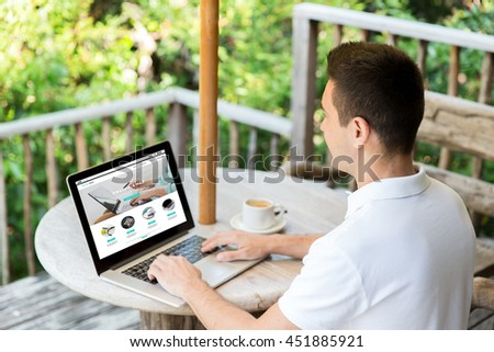 business, internet shopping, people and technology concept - close up of businessman with online shop web page on laptop computer screen on summer terrace drinking coffee - stock photo