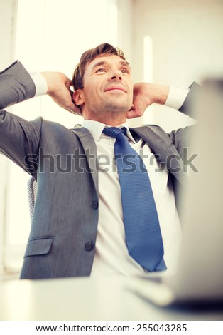 business, internet, technology and office concept - relaxed businessman with laptop computer in office - stock photo