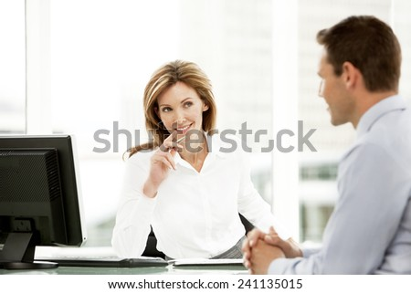Business interview with female manager - stock photo