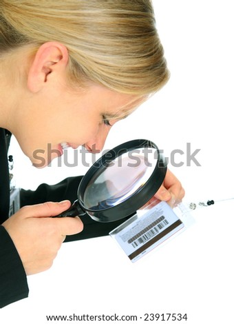 business investigator looking at tag id with loupe - stock photo
