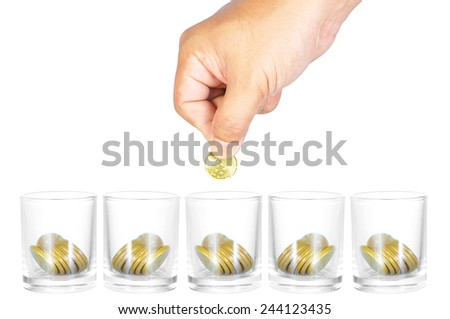 Business, investment or education saving concept - Hand putting coins to the glass while other glasses waiting isolated on white. - stock photo