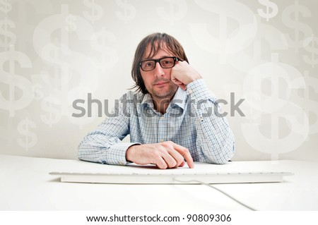 Business investments. Businessman siting at the office desk and thinking about possible dollar long term investments. - stock photo