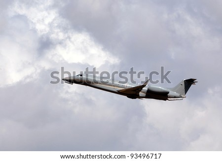 Business jet airplane in gray color - stock photo