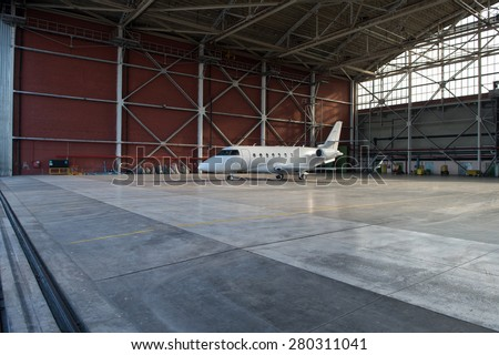 Business jet airplane is in hangar. - stock photo