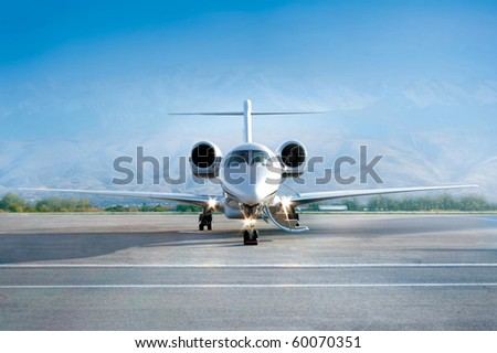 business jet airplane on airfield