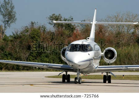 Business jet shortly after arrival - stock photo