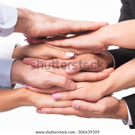 Business, job and work concepts. Professional business team demonstrating unity in photostudio isolated on white background. - stock photo