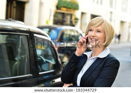 Business lady attending phone call - stock photo