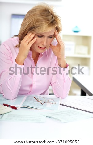 Business lady having headache.
