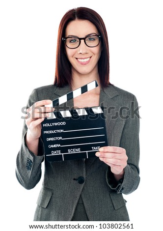 Business lady holding clapperboard. Shot on white background