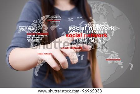Business lady pushing Social Network world map. - stock photo