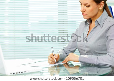 Business lady putting signatures on documents