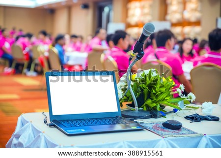 business laptop and microphotone at Table on seminar conference education - stock photo