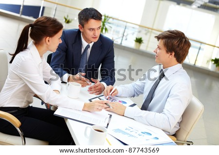 Business leader asking his employees about results of work