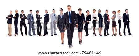 Business leaders walking with their team behind isolated on white