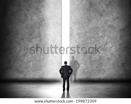 Business leadership concept with a businessman opening a straight path to success - stock photo