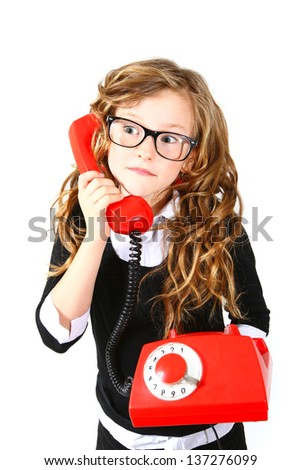 Business little girl with a red phone on  white background - stock photo
