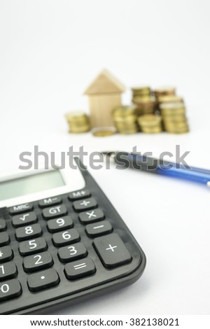 Business Loan Concept: Calculator and Stack of Coins as background - stock photo