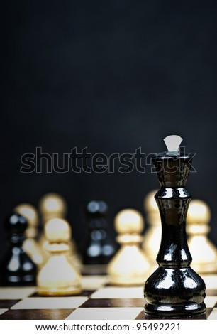 Business look concept in chess game - stock photo