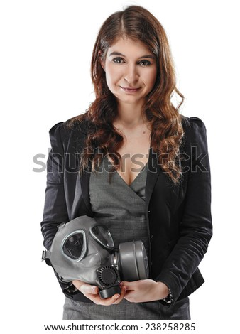 Business looking young adult woman posing with a personal gas mask on her lap - white background - stock photo