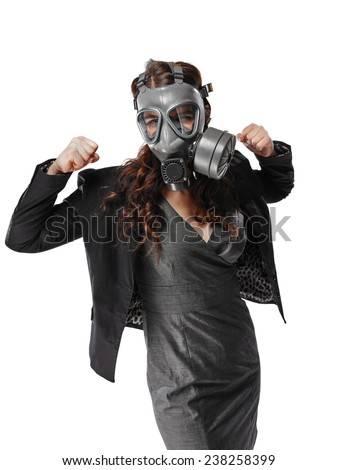 Business looking young adult woman wearing a personal gas mask and she raise arms and fists up - white background - stock photo