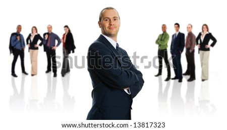 business ma blue jacket with his business team - stock photo