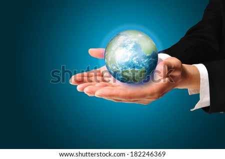 Business Male hand hold earth globe for use as illustration