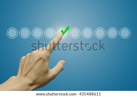 Business male hand touching, pressing modern button and ticking check box out of empty boxes on digital screen interface. Isolated on grey. Business technology concept. Stock Image - stock photo